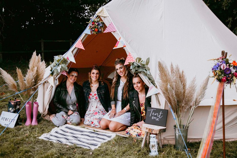 Girls sitting in tipi at hen party