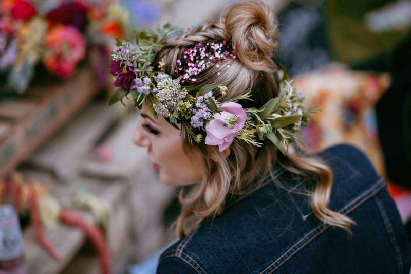 Girl at hen party with flowers in her hair