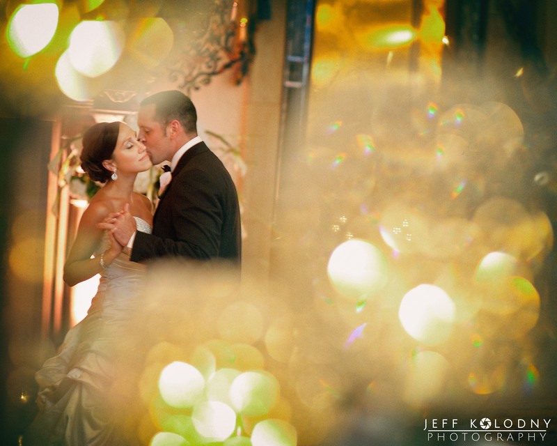 Groom kissing bride on cheek - Picture by Jeff Kolodny Photography