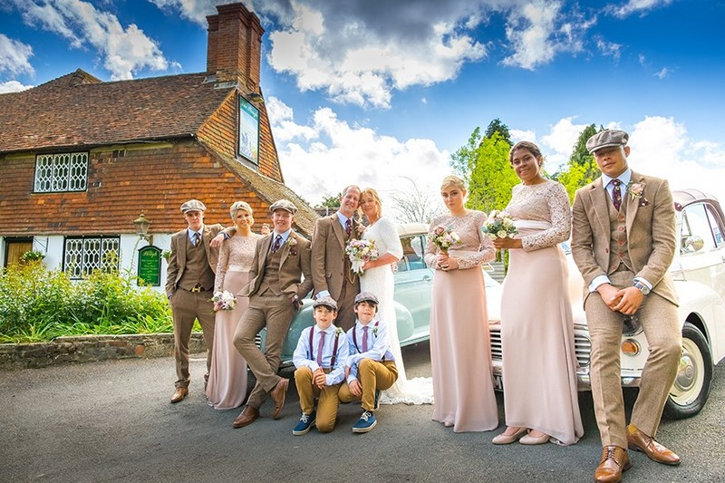 Bridal party in Peaky Blinders type clothing posing for group shot - Picture by Terence Joseph Photography