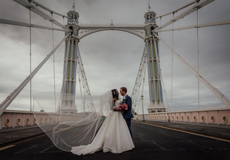 Bride and groom on Albert Bridge in London - Picture by Benjamin Wetherall Photography