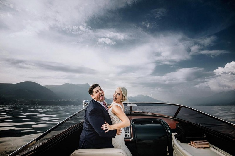 Bride and groom on boat pulling funny faces - Picture by Nicola Tonolini