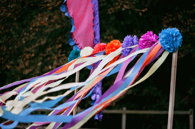 Colourful paper pom poms and streamers