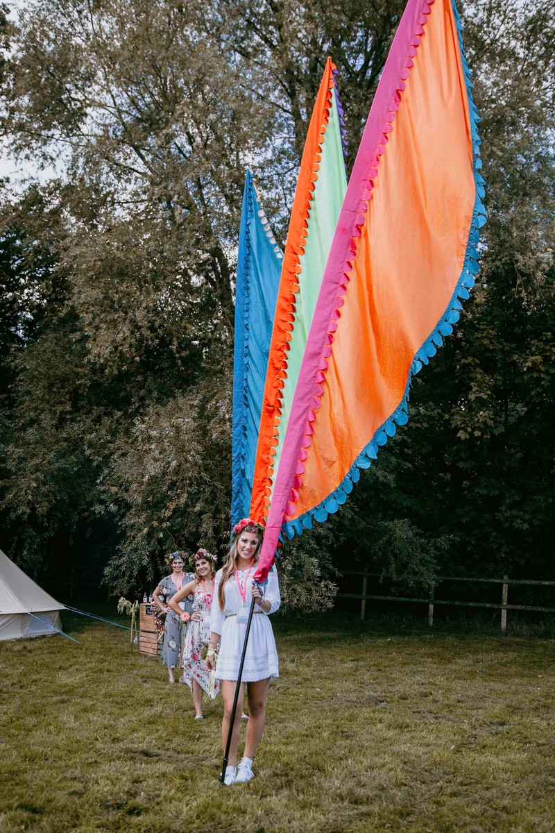 Girls at hen party holding large festival flags