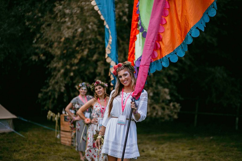 Girls at hen party holding colourful festival flags
