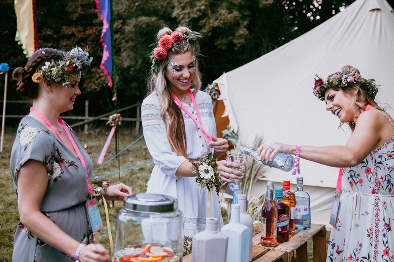 Girls on hen party making drinks at gin bar