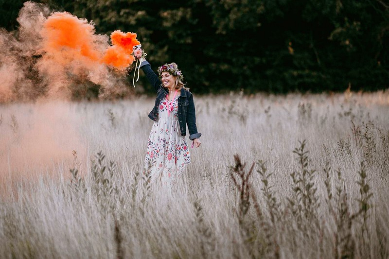 Girl holding orange smoke bomb