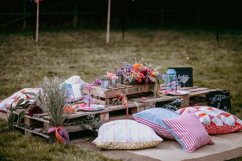 Seating area of cushions and pallets for festival hen party