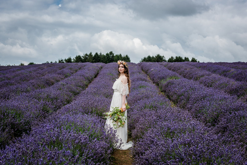 Bride standing in Cotswold Lavender Field