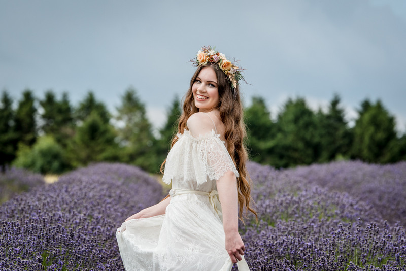 Bride twirling in field of lavender