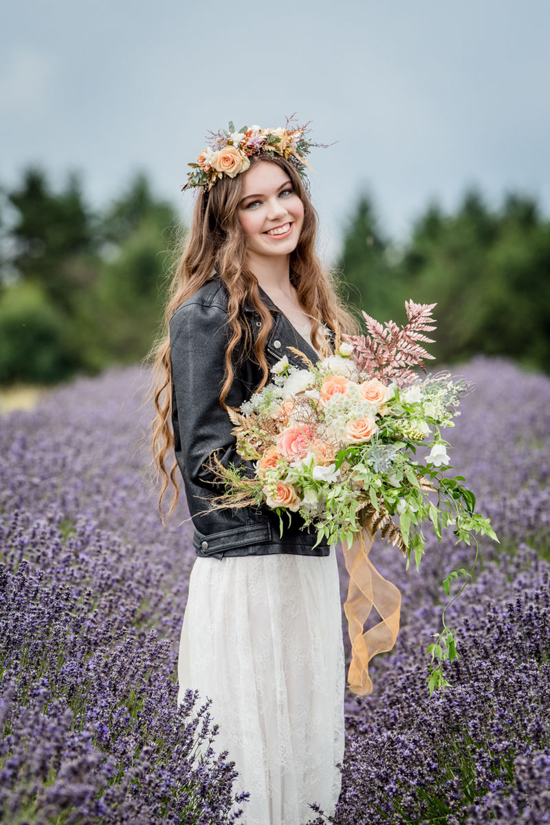 Bride wearing leather jacket and flower crown in lavender field
