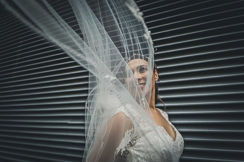 Bride with veil blowing over her face - Picture by Paul Kyte Photography