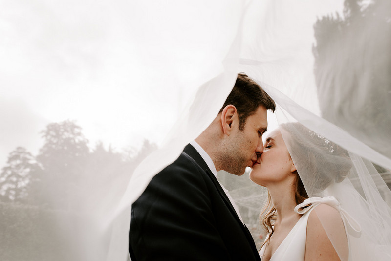 Bride and groom kissing under bride's veil - Picture by Michelle Cordner Photography