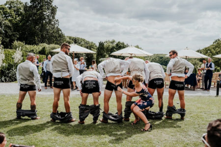 Groomsmen with trousers pulled down - Picture by Ryan Goold Photography