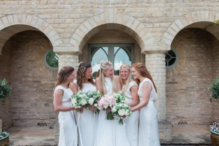 Happy Bride Laughing with Bridesmaids