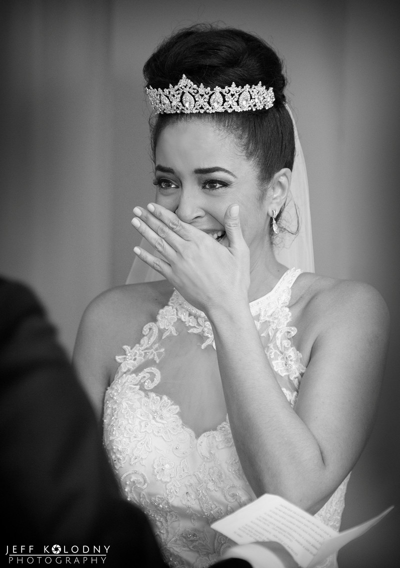 Emotional bride during wedding ceremony - Picture by Jeff Kolodny Photography