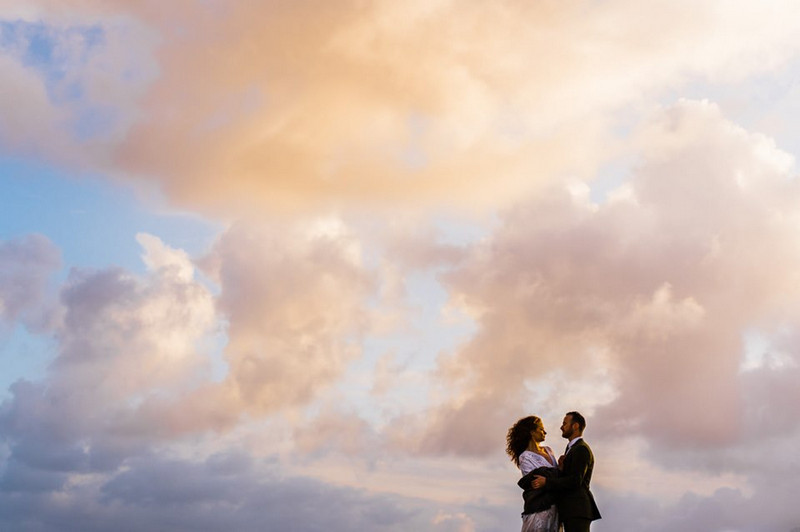 Clouds in sky behind bride and groom - Picture by Babb Photo
