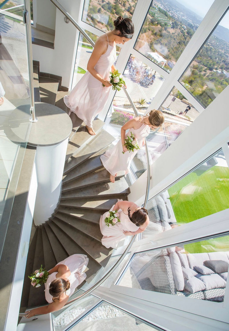 Bridesmaids walking down spiral staircase - Picture by Chilli Pepper Productions
