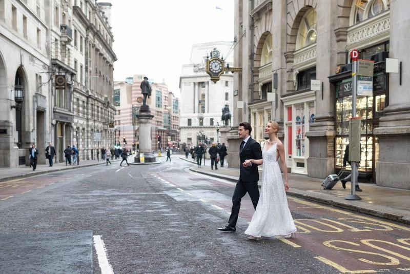 Bride and groom crossing road in London