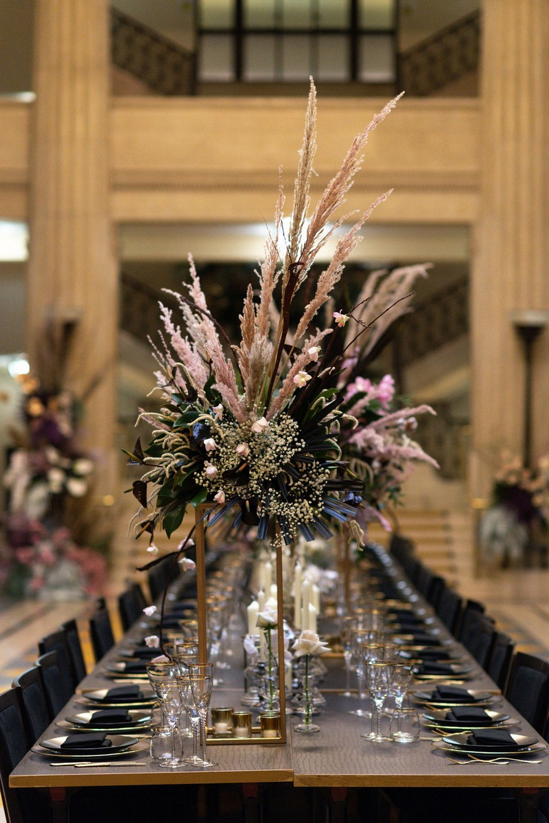 Large statement floral display on wedding table