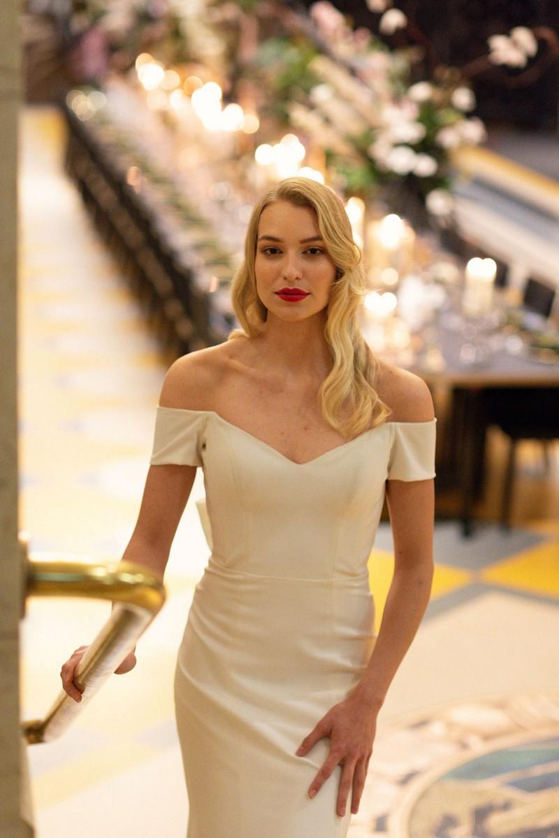 Bride wearing off the shoulder wedding dress