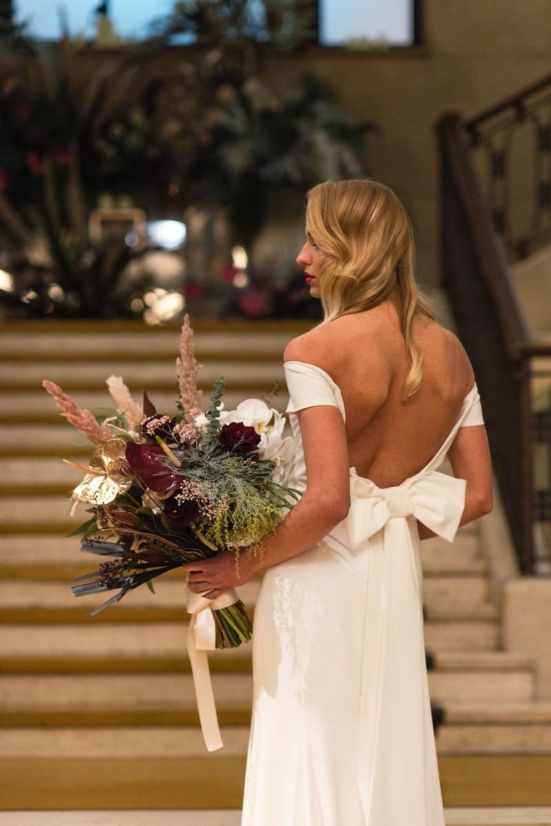 Bride holding large bridal bouquet