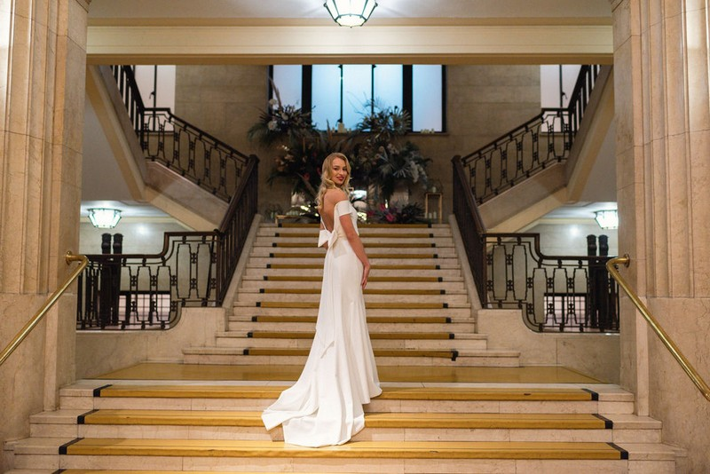 Bride on stairs of Banking Hall, London
