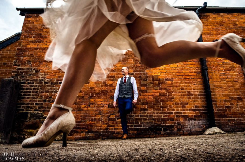 Groom standing against wall as bride's legs run past - Picture by Rich Howman