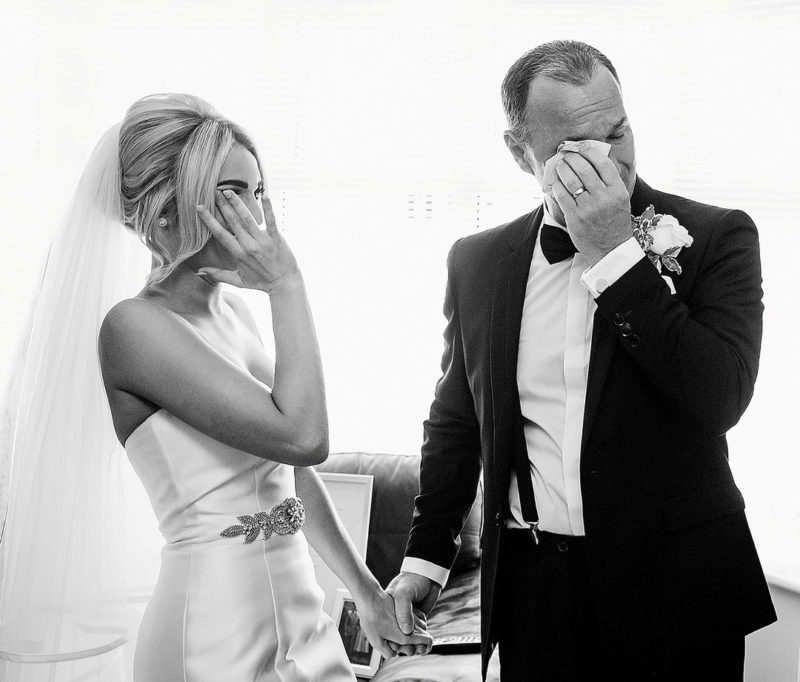 Bride and groom both wiping away tears - Picture by Focal Point Photography