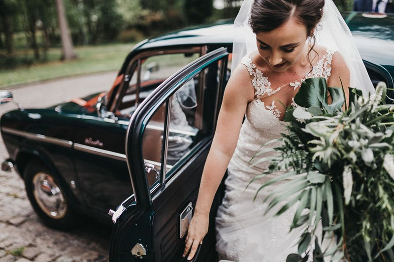 Bride getting out of wedding car - Picture by Kev Elkins Photography
