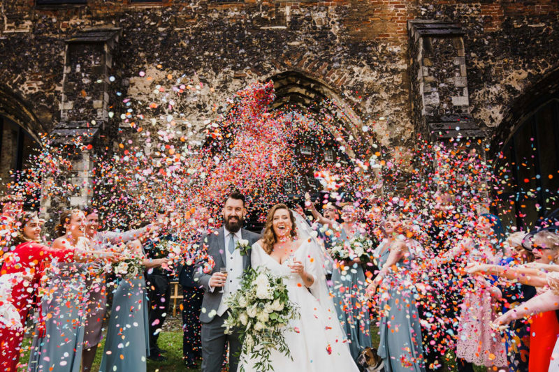 Bride and groom being showered in lots of confetti - Picture by Rob Dodsworth Photography