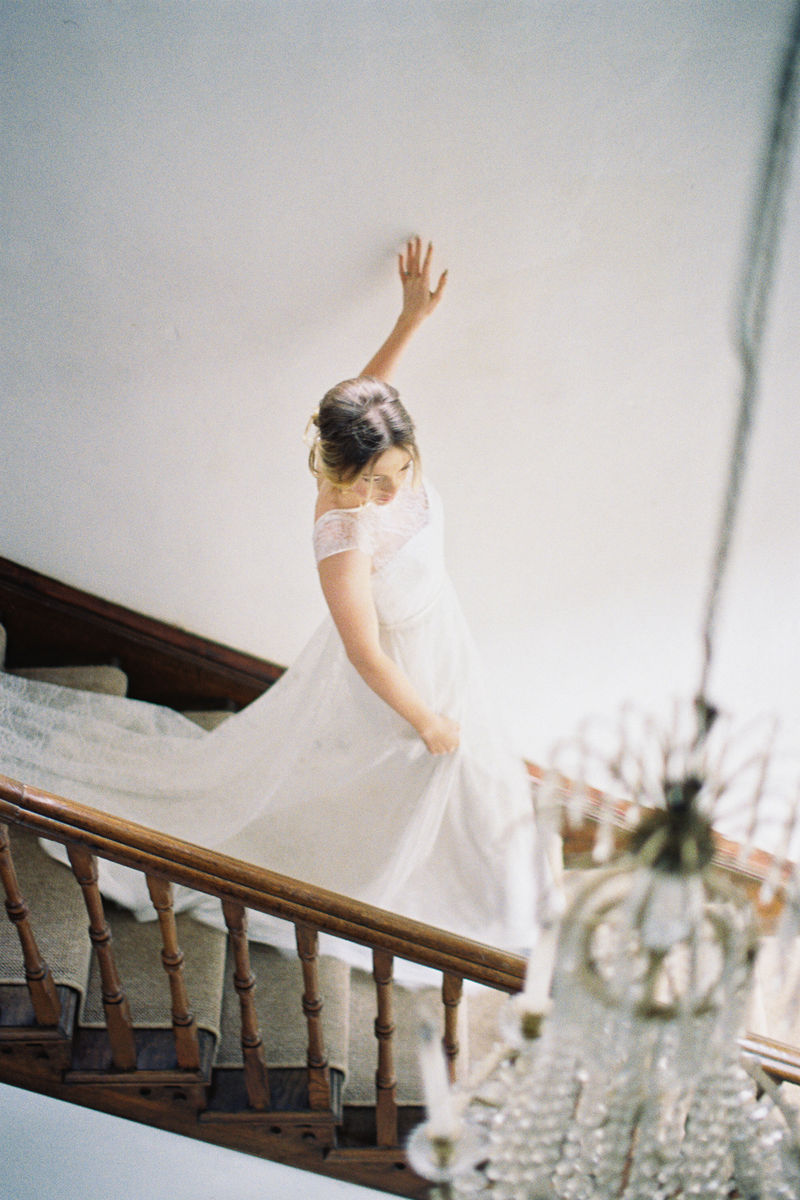 Bride walking down the stairs - Picture by Liz Baker Photography