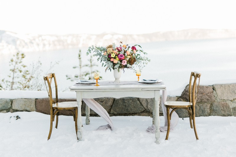 Flowers on elopement table in snow