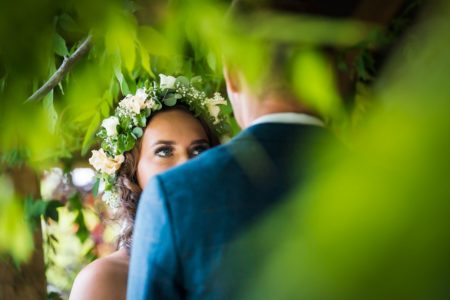 Bride with flower crown staring into groom's eyes - Picture by Nick Church Photography
