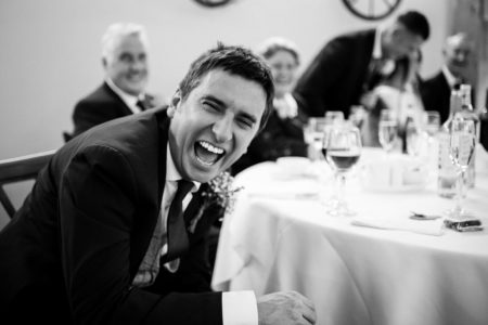 Man laughing at wedding - Picture by Damian Burcher