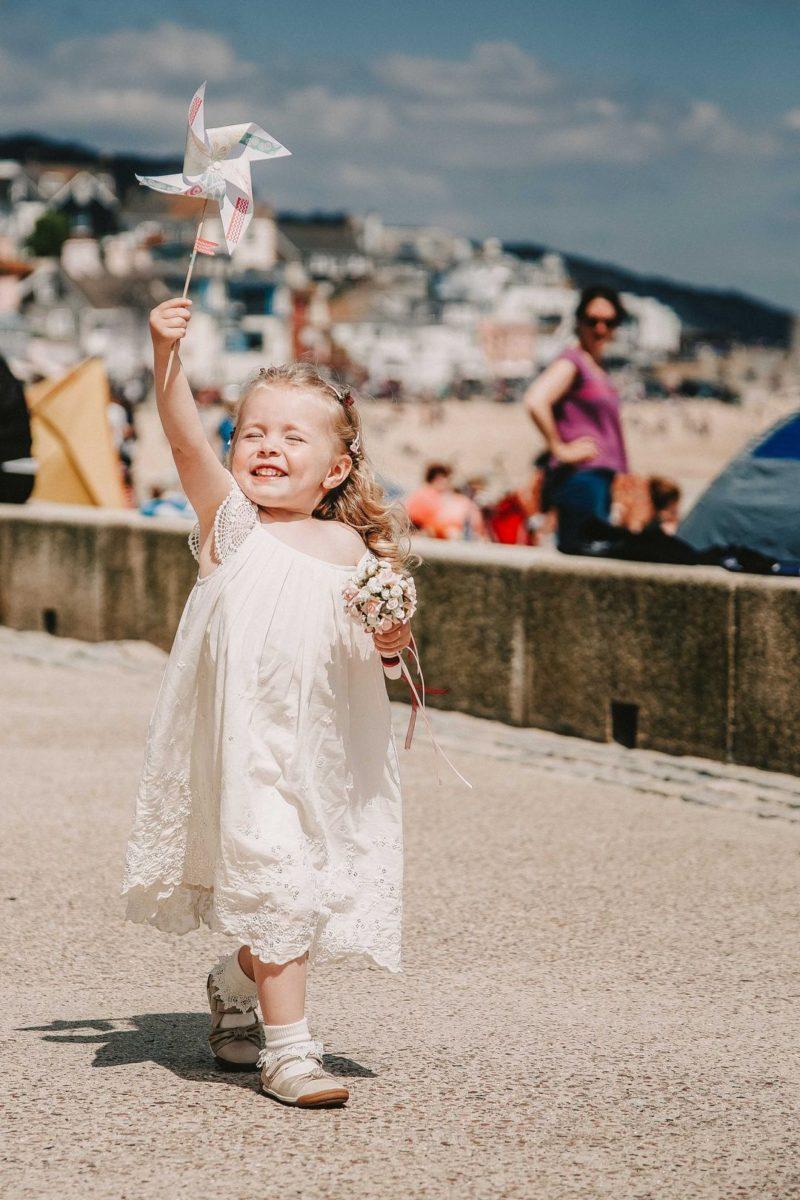 Flower girl holding pinwheel