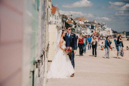 Bride and groom on Lyme Regis seafront