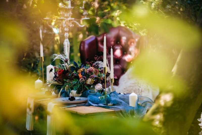 Colourful wedding table flowers and candles