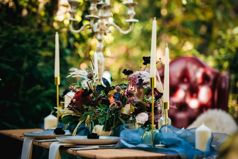 Flowers on wooden wedding table in woods