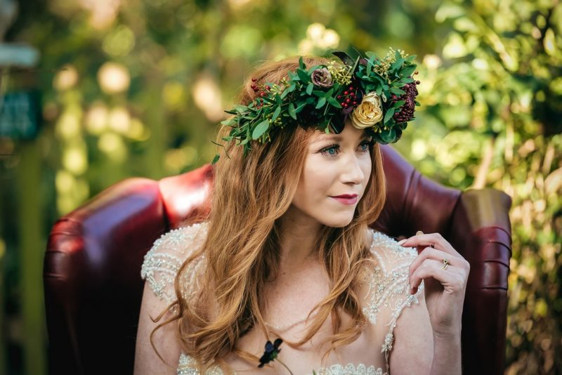 Bride with red hair wearing flower crown