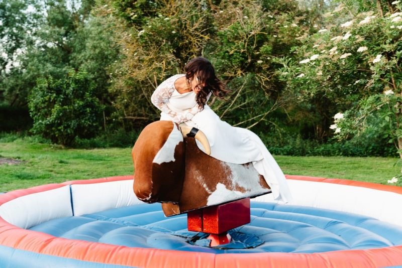 Bride on bucking bronco ride - Picture by Fiona Kelly Photography