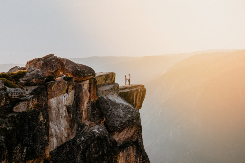 Couple standing on edge of cliff - Picture by Lilly Sells Photography