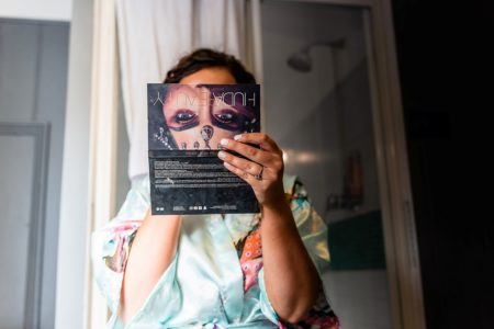 Bride holding picture of face in front of her own - Picture by Piccolino Photo Studio