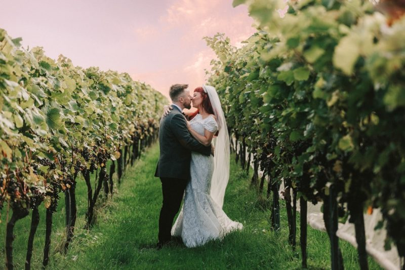 Bride and groom about to kiss in vineyard - Picture by Andrew George Photography