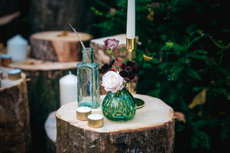 Glass vases on wooden stumps