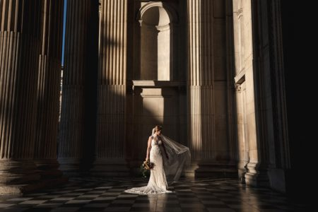 Bride standing in entrance to St Paul's Cathedral - Picture by Rik Pennington Photography