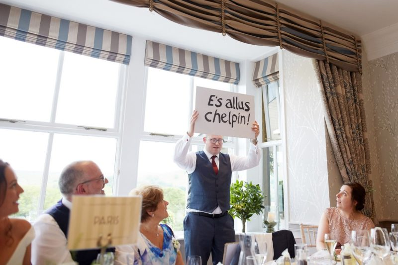 Best man holding up sign during speech