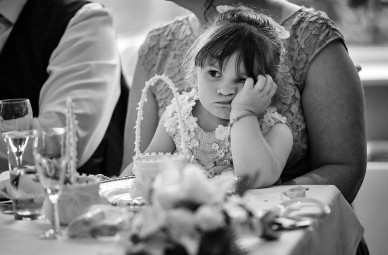 Young girl bored at wedding