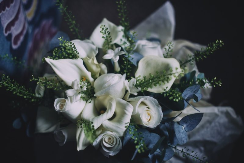 White roses and lilies in wedding bouquet
