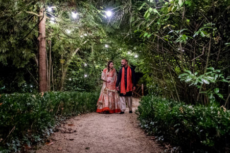Bride and groom walking through grounds of Manor by the Lake - Picture by Capture Every Moment